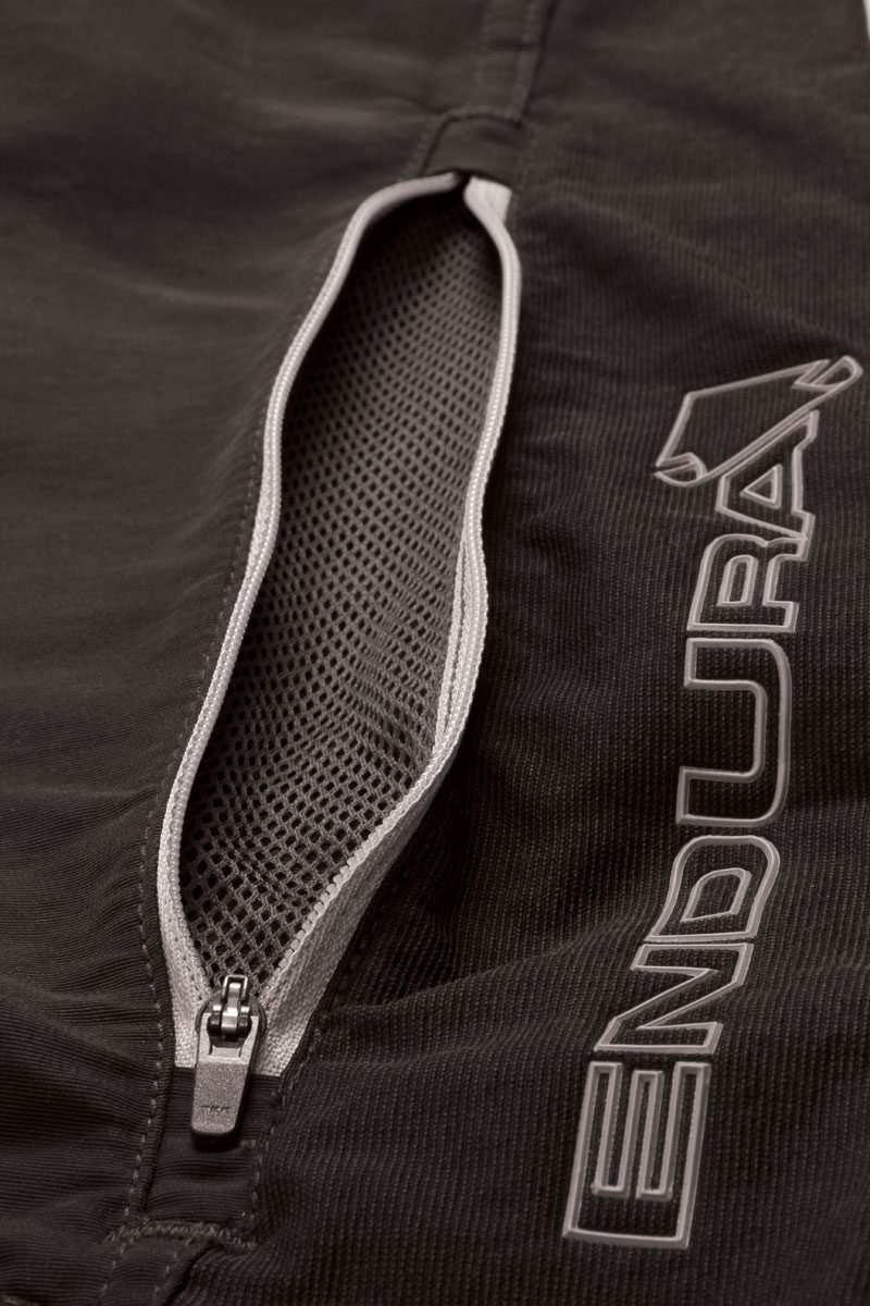 Thigh vents with contrast zippers and mesh inserts