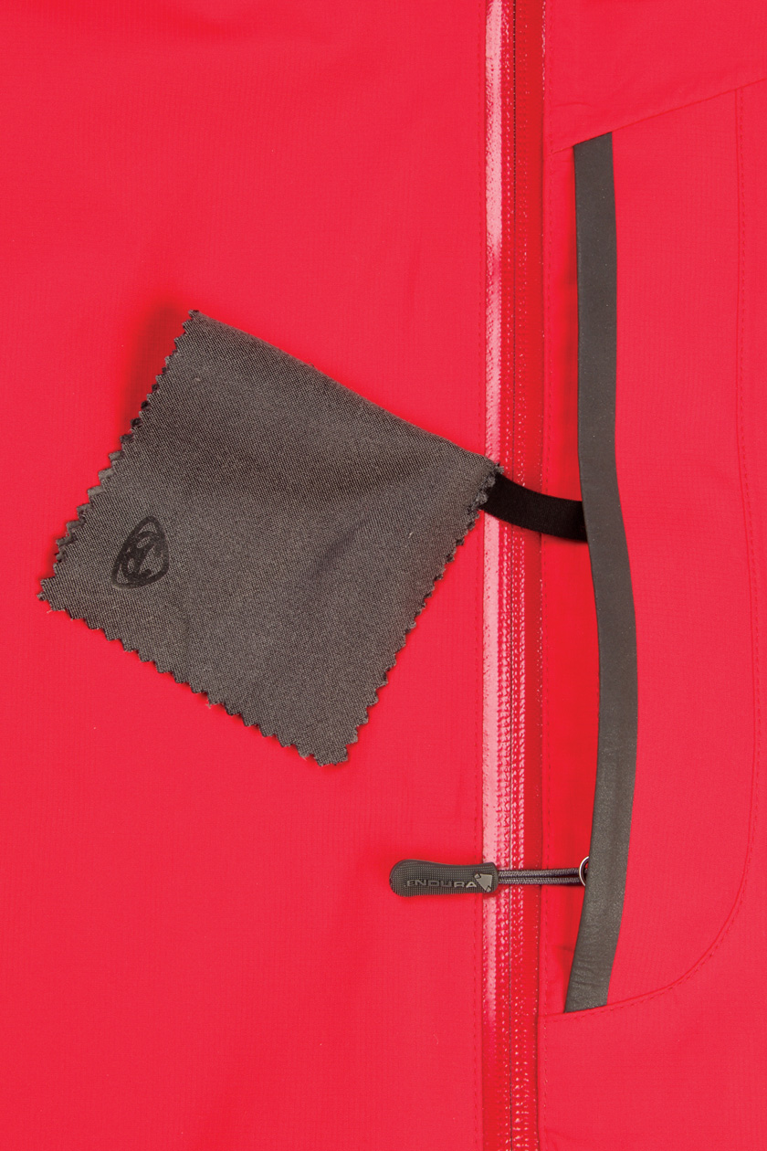 Waterproof zipper Napoleon pocket with integral glasses wipe and media port