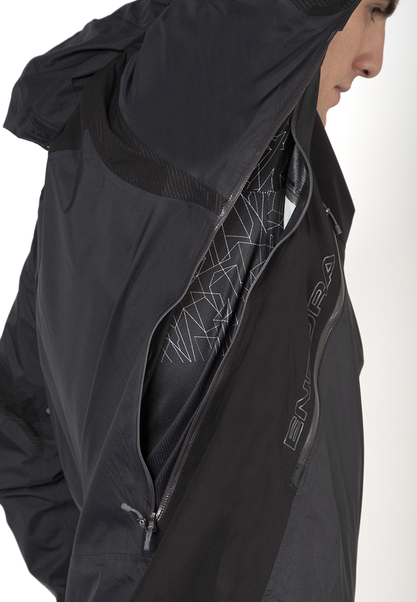Ventilation by large underarm 2 way zipped vent extending onto back, compatible with back pack
