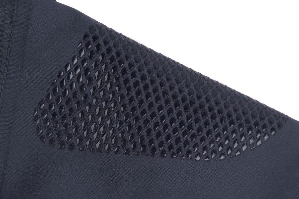 Ergonomically positioned stretch shoulder panels
